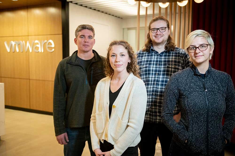 A group of Northeastern co-op students and alumni at VMWare Genevieve Epstein (facing) and Liam Weldon Liam Weldon David Silvia Sasha Rudyakov