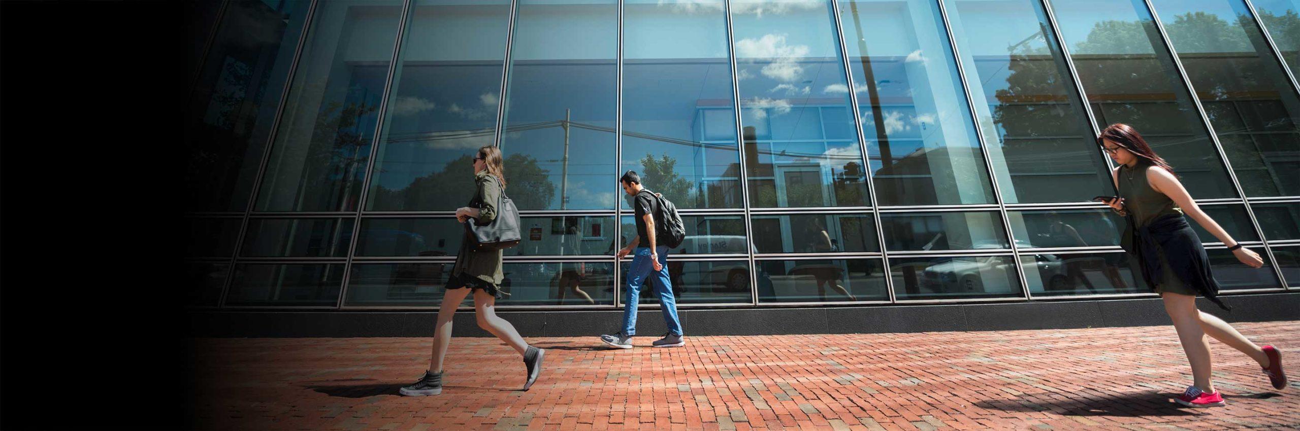 People walk outside West Village H