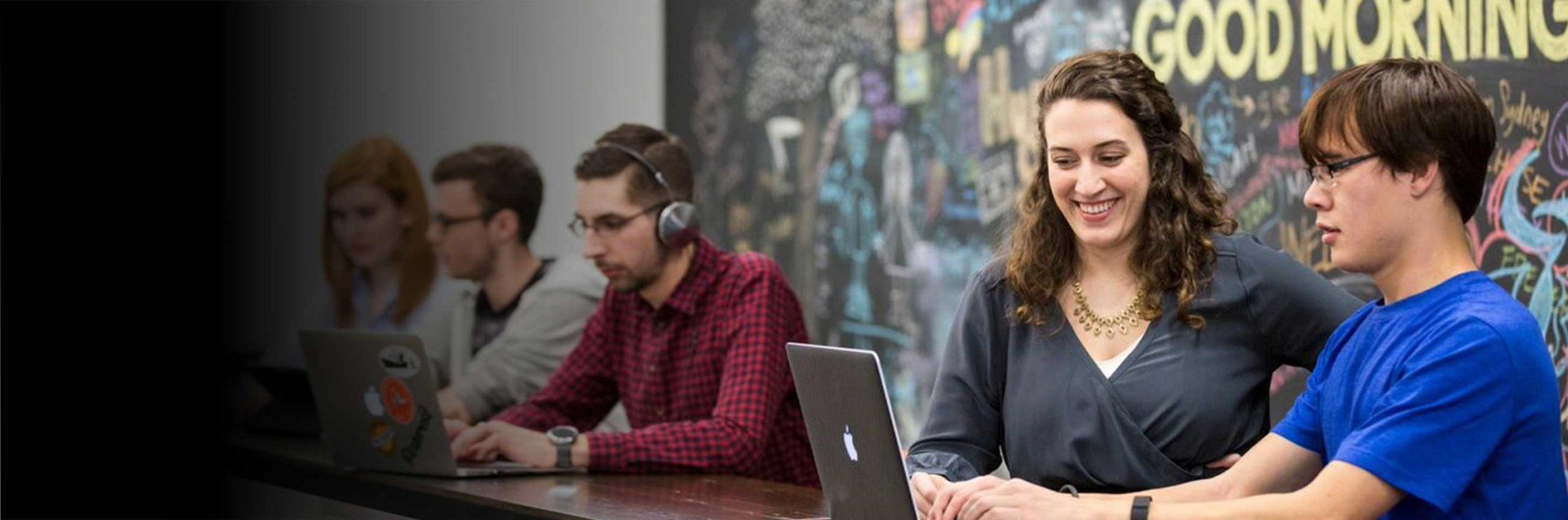 Students talk at a co-op job