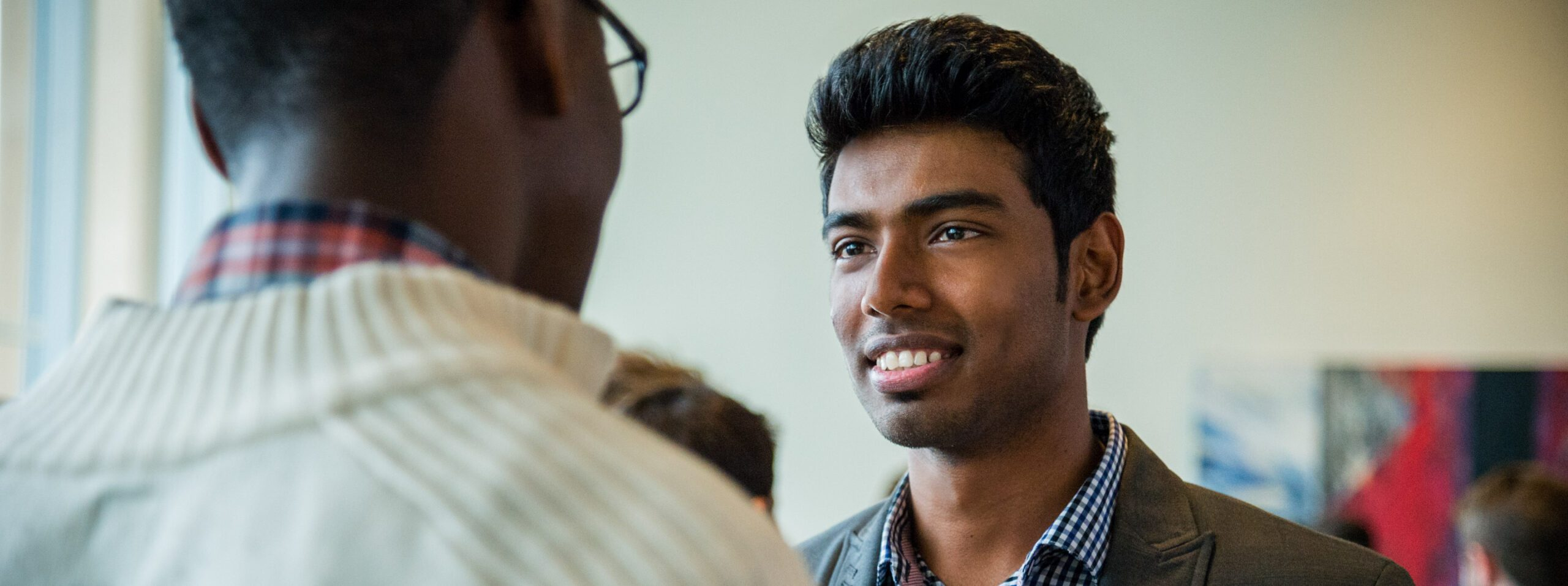 Students talk at a campus event