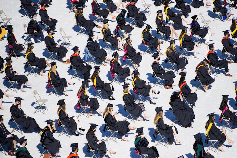 Graduates sitting in the field