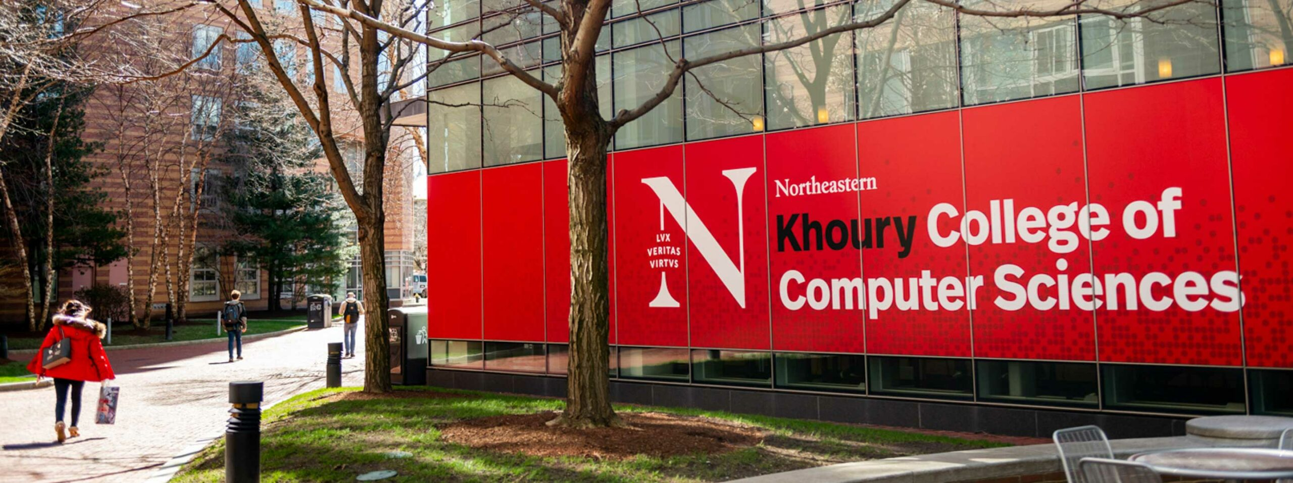 A view of the Khoury College banner outside West Village H
